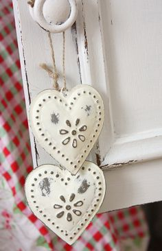 white painted tin hearts