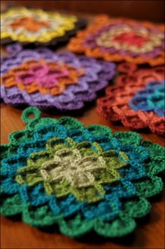 Crocheted potholders. a little more intricate looking than the standard granny square.