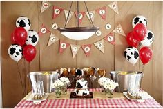 Love the sign and cow balloons!