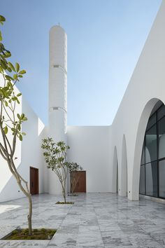 Ibda Design uses contrasting sandstone and white marble for mosque in Dubai Arched openings in the sandstone facade of this Dubai mosque by Ibda Design lead worshippers into a bright marble courtyard. Mosque Architecture, Library Architecture, Religious Architecture, Contemporary Architecture, Landscape Architecture, Interior Architecture, Minimal Architecture, Architecture Quotes, Residential Architecture