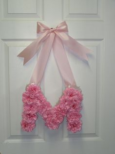 This would be so cute for as a baby girl's nursery wall hanging.