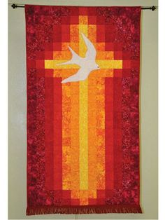Quilt a divine and stunning banner. This beautiful, simple banner celebrates the Pentecost in a straightforward and bold way. The cross becomes a flame, and a dramatic use of color with batiks makes it really dynamic. This banner makes a great East. Hanging Quilts, Quilted Wall Hangings, Log Cabin Quilts, Barn Quilts, Cross Patterns, Quilt Patterns, Quilting Projects, Quilting Designs, Church Banners Designs