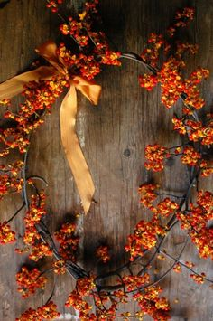 Bittersweet vine produces bright berries in the fall so it makes for a festive way to decorate for a fall wedding. Bittersweet Vine, Fall Wreaths, Door Wreaths, Fall Harvest, Harvest Moon, Harvest Time, Autumn Home, Autumn Inspiration, Wedding Inspiration