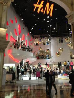 H, a moderately priced mass retailer from Sweden - they are creating a soaring, clublike experience for the shopper (target demographic is 17-25). Soaring ceilings, three stories of sales floor, gleaming mirrored disco balls, high gloss surfaces all communicate their fun, trendy vibe.