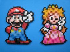 Nintendo Super Mario and Princess Peach Perler Bead Sprite Decoration Set. $10.00, via Etsy.