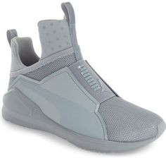 In collaboration with Rihanna's Fenty label, PUMA takes street style to the extreme with an architectural shoe that's a high-fashion spin on the classic training sneaker. An exaggerated heel and extra-high tongue update the slip-on silhouette, while a mesh vamp and an elastic cage overlay provide breathability and maximum lockdown. <ul> <li>Slip-on style.</li> <li>Medial and lateral support for 360-degree movement.</li> <li>Remova