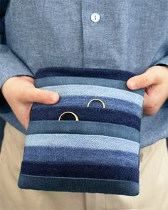 Striped denim ring pillow. Get the how-to http://www.marthastewartweddings.com/225308/striped-denim-ring-pillow-how