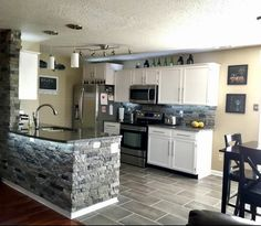 Airstone on island and backsplash. Luxury vinyl tile in kitchen with white scrubbable grout. Stone Kitchen Island, Kitchen Island Bench, White Kitchen Island, Airstone Backsplash, Vinyl Backsplash, Kitchen Vinyl, Diy Kitchen, Kitchen Decor, Modern Home Bar Designs