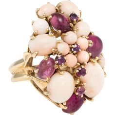 Overview: Elaborate vintage cocktail flower ring, (circa 1950s to 1960s), crafted in 14 karat yellow gold. Angel skin coral graduates in size and