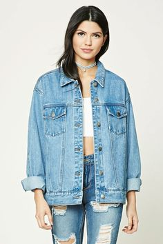 An oversized denim jacket featuring back landscape and cityscape patches, a basic collar, buttoned placket, long button-cuff sleeves, front button flap pockets, front welt pockets, hidden interior pockets, and a longline silhouette.
