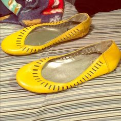 Bright yellow flats size 5 in women's These bright flats are sooo cute! I bought them to wear and they were wayyyy too small on me. I only wore them once for about 2 hours. They've been in my closet for approximately for years. Vanity Shoes Flats & Loafers
