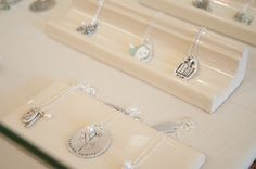 jewelry display on tile trim {lisa leonard} (i gotta keep this in mind for the next Zerolandfill Chicago)
