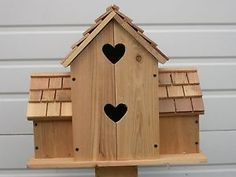 hand made bird house with hearts