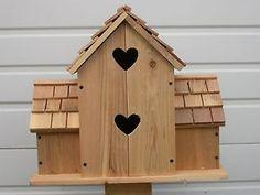 hand made bird house with hearts