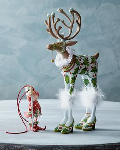 """""""Vixen"""" Reindeer Figure and Elf Ornament by Patience Brewster at Horchow."""