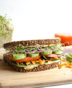 The Ultimate Hummus and Veggie Sandwich piled high with veggies and sprout, loaded with creamy hummus, and held together with sturdy whole grain bread. Meatless sandwiches never looked so good! Hummus Sandwich, Veggie Sandwich, Vegetarian Sandwich Recipes, Healthy Sandwiches, Vegetarian Lunch, Lunch Recipes, Easy Healthy Recipes, Healthy Snacks, Vegan Recipes