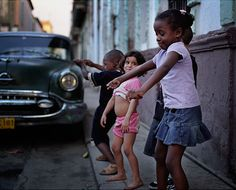 Dancing in the streets. I love it when children dance!