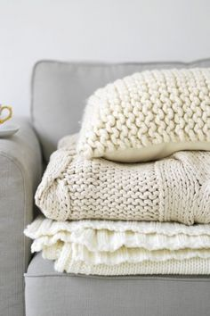 Keep comfy and warm with cream pillows and afghans.