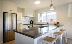 A lovely light and open plan kitchen. Open Plan Kitchen, Black And White, Table, House, Furniture, Home Decor, Decoration Home, Home, Room Decor