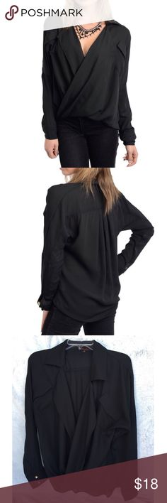 |new| Black Long Sleeved Blouse Very nice black blouse, cross front with long sleeves and pockets in the front. Never worn   ✔️If you'd like to MAKE AN OFFER please do so through the offer button ONLY. I won't negotiate prices in the comments.  ✔️All sale items, items $15 and under, & clearance items are firm unless BUNDLED.  ❌No trades, PayPal, Holds 📷Instagram: @lovelionessie Tops Blouses