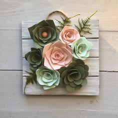 A personal favorite from my Etsy shop https://www.etsy.com/listing/566869156/felt-succulent-vertical-garden-felt