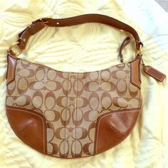 COACH Signature brown and tan small handbag Authentic COACH Signature collection small handbag. Only used once, still have the tag although it's not attached. Comes with the COACH dust bag (which it has been stored in) to keep it clean as well. Coach Bags