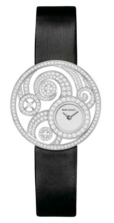 Boucheron Ajouree Volute watch with diamonds set into swirling patterns of open-work white gold.