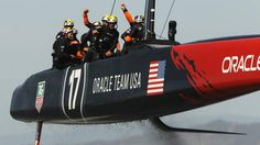 Crew members of Oracle Team USA react after defeating Emirates Team New Zealand during Race 18 of the 34th America's Cup yacht sailing race ...