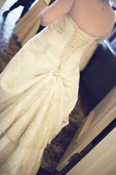 my wedding dress, bustled (bought from Brides Against Breast Cancer). -Finikki