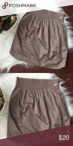 """🍂New Listing!🍂 French Connection Taupe Skirt Adorable French connection skirt in taupe color. This adorable Cinched waist skirt with side pockets and curved hem would be perfect for fall. There is no size listed on the tag but it runs between 2-4.  🔹Measurements: Waist 13 1/2"""" across; length 19"""" from top to bottom French Connection Skirts Mini"""