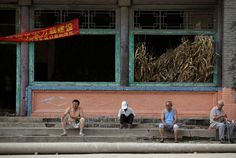 Villagers sit on stairs outside an abandoned old theatre building in an area where land is sinking near a coal mine in Kouquan township of Datong, China's Shanxi province, August 1, 2016. REUTERS/Jason Lee           SEARCH 'SINKING CHINA' FOR THIS STORY. SEARCH 'THE WIDER IMAGE' FOR ALL STORIES. via @AOL_Lifestyle Read more: https://www.aol.com/article/news/2017/07/10/sweden-ranked-best-country-to-be-an-immigrant/23023633/?a_dgi=aolshare_pinterest#fullscreen
