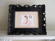 Magnetic, fabric, baby picture frame. Notice the rhinestone magnet?