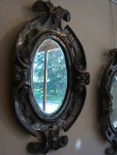 #Pair of mirrors made of #cast. The mirrors are decorative elements of a large garden gate. Period #19th century. Beveled mirrors. For sale on #Proantic by Antiquités Saint Roch.