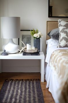 nailhead uphostered headboard, vented lantern as a vase, and west elm lamp.  love the antlers too.  rue by tammi