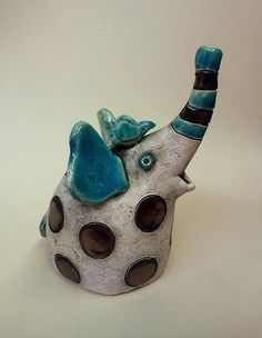 Handbuilt ceramic sculpture. Covered with glazes . Electric high-fired at 1080 C degree. Height: 12 cm (~ 30.5 inches). ~ This figurine is from the black&turquoise blue series. I really like this combination, and the points create a cheerful mood. The elephant is a very good gift for