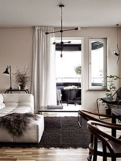 A black, beige and pink Stockholm apartment