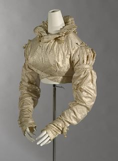 Spencer, c. 1819. NGV, D24-1972.  Figured silk. 39.0 cm (centre back) 67.5 cm (sleeve length). England.