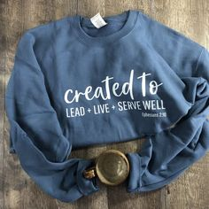 PRE-ORDER BEFORE DEC This incredibly cozy crewneck sweatshirt comes in 4 colors to provide you a daily reminder that you are ready-made in Christ (Ephesians Celebrate your worth in the ways that you LEAD + LIVE + SERVE Well! Christian Clothing, Christian Shirts, Christian Apparel, Diy Camisa, Cute Shirt Designs, Jesus Shirts, Vinyl Shirts, Graphic Sweatshirt, T Shirt
