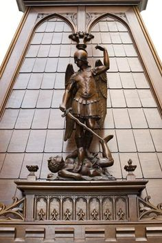 Beautiful antique Neo-Gothic style fireplace in sculpted walnut with hood, representing St Michael slaying the demon (Reference - Available at Gallery Marc Maison Architectural Antiques, Fireplace Mantel, St Michael, French Decor, Middle Ages, Gothic Fashion, French Antiques, Sculpting, Saints