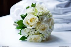 Bridal Hand-Tie Bouquet Hand-Tie Bouquet of white Avalanche roses, white bouvardia, white freesia and pearls, by Exclusively Weddings. Photo by Meonshore Weddings