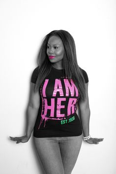 """""""I AM HER"""" EST. 1908 AKA Inspired Women's Fitted Tee: Be Bold, Daring and Fearless! EST. 1908 AKA Fitted Tee intended to celebrate the legacy of Alpha Kappa Alpha Sorority Incorporated. I AM HER Apparel is for the girl who knows who she is, who knows who she is called to be and is unapologetic to leave her mark in the world as a reminder that she was here. EST.1908 piece to be worn as a fitted tee with a comfy fit."""