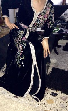 Dress made by Caftan Tetouani.The decoration on the dress is paint.