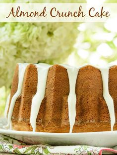 Almond Crunch Cake is loaded with crunchy slivered almonds, a surprise marzipan filling inside, and is drizzled with an almond glaze. Bake this bundt for anyone who loves almonds.