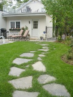 Flagstone pathway cuts across the lawn - this is what OUR walkway will look like!