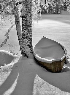 Snowy rowboat patiently waiting for springtime in Finland • photo: Ari Salmela on FineArtAmerica