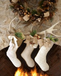Love the natural look of these Christmas stockings—The embellishments are cool And, using an antler to hang them from is genius! French Laundry Home Country Christmas Stockings - Horchow Christmas Photo, Noel Christmas, Little Christmas, Country Christmas, All Things Christmas, Winter Christmas, Christmas Stockings, Christmas Crafts, Burlap Stockings