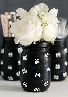 Halloween mason jar set of three pint-sized mason jars painted and lightly distressed in black with white google eye. Or boo eyes? Not sure what to call the eyes. Any suggestions are welcome!  :)  Perfect for Halloween and fall décor to hold flowers or candles or candy. Great for Halloween party or Halloween gift idea.  The insides of the jars are not painted, so it's okay to put water in them. The exteriors have been sprayed with a matte enamel protective coat. Do not submerge in water or…