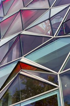 Differently coloured and shaped triangles to create windows