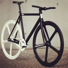 Black & White. Bicycle. Urban. Hip. Youth. Custom. Aerospoke. 8bar. Clean. Design. Modern. New. Concrete. City. Branded.