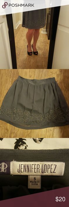FINAL PRICE Beaded gray skirt Beautiful geay skirt with beads, never worn. (Necklace, sweater and purse also listed) Jennifer Lopez  Skirts